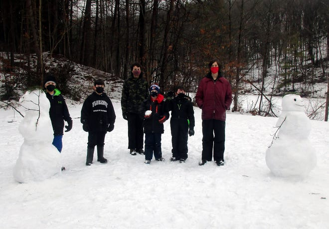Cub Scouts from Oneida-based Pack 2 were joined Jan. 16 by some of their elder Boy Scout friends and family members for a winter hiking event. The scouts and guests hiked along the trails of the Mount Hope Reservoir in Oneida before gathering afterwards to build snowmen and enjoy healthy snacks of trail mix and juice. The event was designed to get the youth outdoors for some fresh air and exercise and both the scouts and their friends agreed they should do it more often.