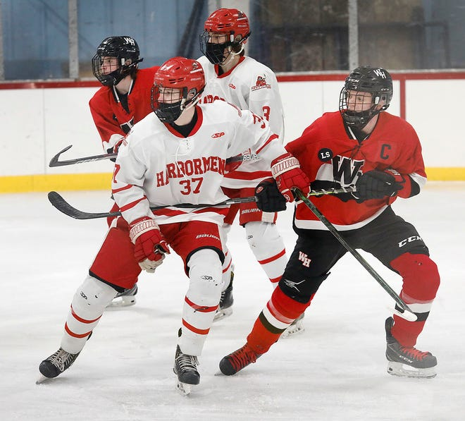 Hingham #37 sophomore Aidan Brazel looks for a pass from a teammate while W-H captain Kevin Willis defends. The Hingham Harbormen host W-H Panthers in hockey on Monday January 18, 2021 Greg Derr/The Patriot Ledger