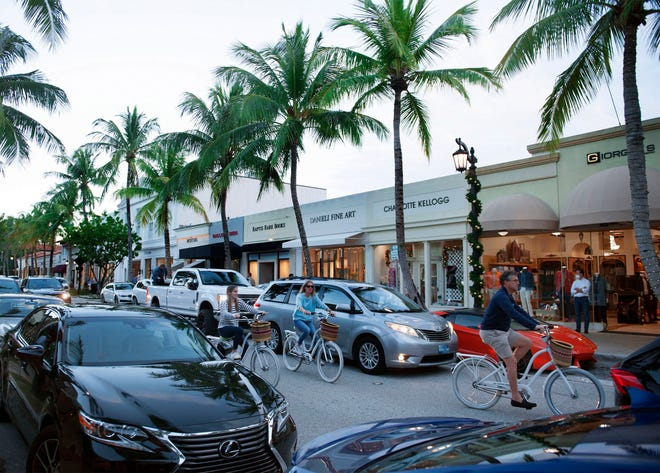 Finding parking is sometimes difficult on Worth Avenue. On Dec. 12, the Avenue is filled with motorists, pedestrians and cyclists.