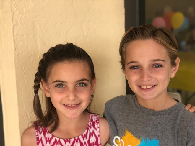 Dylan and Isaac Goby show off their cute new haircuts after donating locks to St. Baldrick's to help end children's cancers.