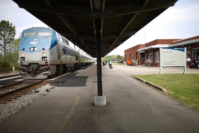 Passengers board a southbound Amtrak train at the Petersburg terminal in Ettrick in this file photo.
