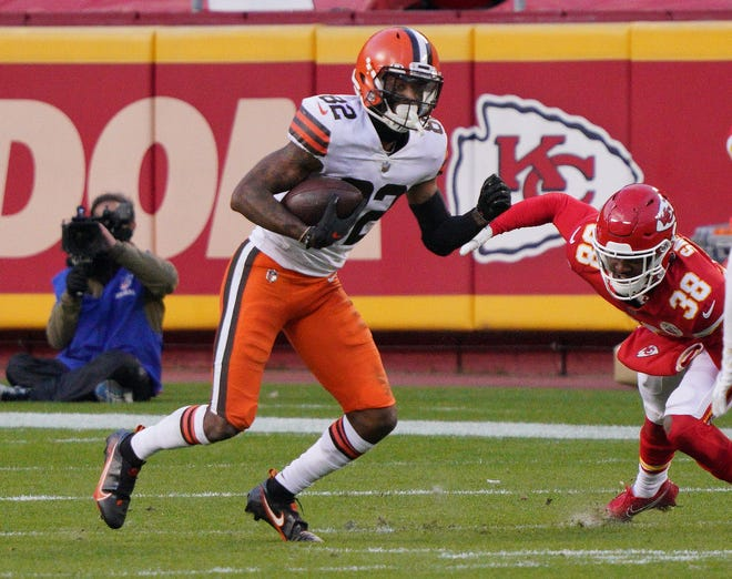 Browns wide receiver Rashard Higgins (82) runs the ball after a catch against the Chiefs during the second half in the AFC Divisional Playoff game at Arrowhead Stadium, Jan. 17, 2021, in Kansas City, Mo. (Denny Medley-USA TODAY Sports)
