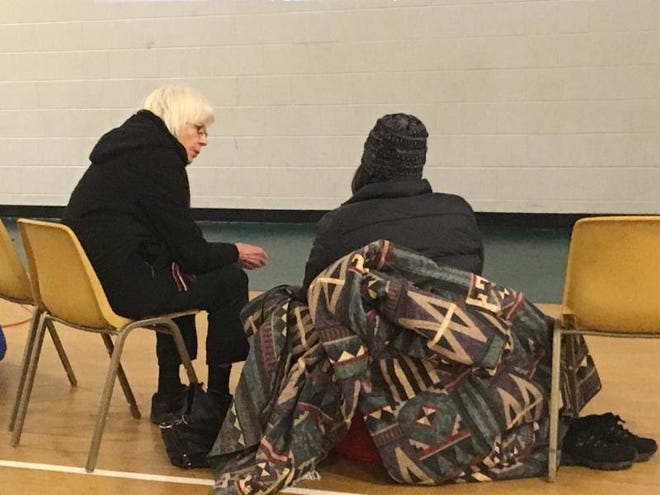 SecondFirst Church member and Rockford Overnight Café volunteer Joanne Johnson speaks with a guest who took shelter in the church gym on one of the coldest nights in Rockford history in late January 2019. It operated for 10 weeks in 2020. The Overnight Café is opening again this winter with limited capacity because of the novel coronavirus pandemic.