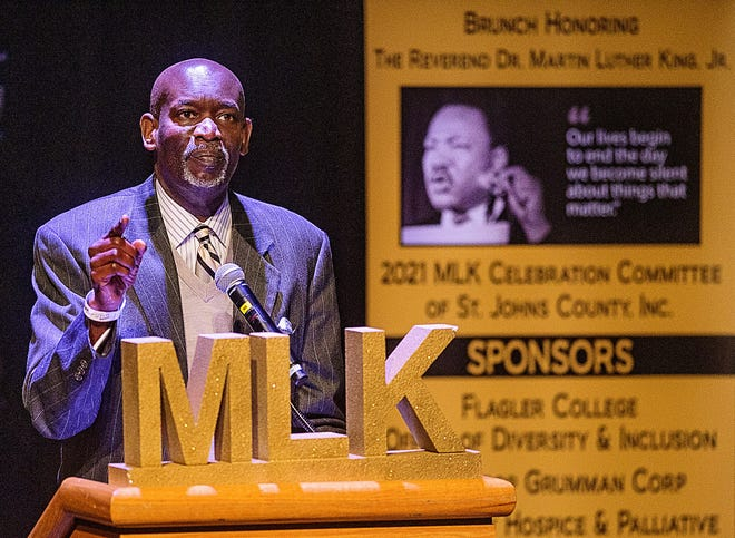 The Rev. Kevin James, pastor of the United Methodist Church in Palm Coast, speaks at St. Augustine's 36th annual Dr. Martin Luther King commemoration in Flagler College's Lewis Auditorium in the city on Monday. Because of COVID-19 concerns, the event was livestreamed over the internet and had limited in-person attendance.