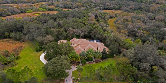 An 8,000-square-foot home is surrounded by wetlands and trees at The Forest at Hi Hat Ranch. The owners of Hi Hat Ranch are asking county officials to approve a master plan that would lay the groundwork to develop the remaining 10,000 acres of the property.