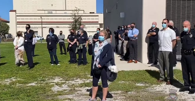 Sarasota Police Chief Bernadette DiPino, center, and members of her department watch a special performance of the Sarasota Opera held outside their headquarters Nov. 18, 2020. DiPino is under fire for comments she made about a homeless man who heckled her officers during the performance.
