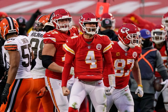 Kansas City Chiefs quarterback Chad Henne celebrates after a run during the second half of an NFL divisional round football game against the Cleveland Browns, Sunday, Jan. 17, 2021, in Kansas City.
