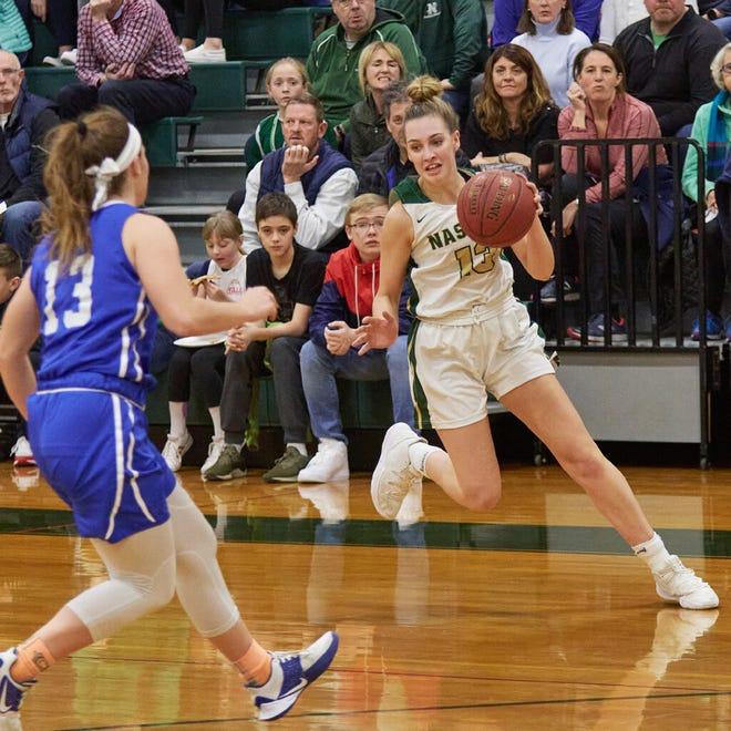 Jillian Payne, with the ball, is one of the seasoned seniors on the Nashoba Regional girls' basketball team this season.