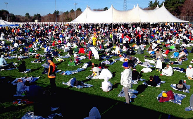 Runners wait in the Athletes' Village in Hopkinton before the 2015 Boston Marathon.