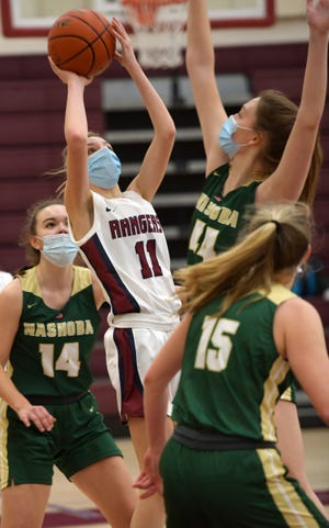 Westborough's Amanda Beckman gets a shot off while surrounded by Nashoba players during a girls basketball game on Jan. 18, 2021. Beckman helped her team rally to beat Marblorough on Monday.