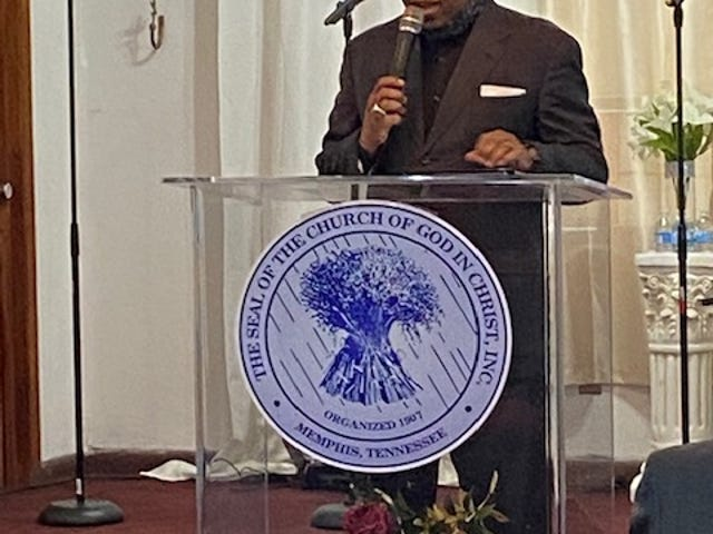 Dr. D.E. Richardson II, pastor of Temple of Praise and Restoration Outreach Center (TOPROC) Church of God in Christ, celebrates the church's 24th anniversary during a worship service on Sunday. [Photo by Aida Mallard/For The Guardian]