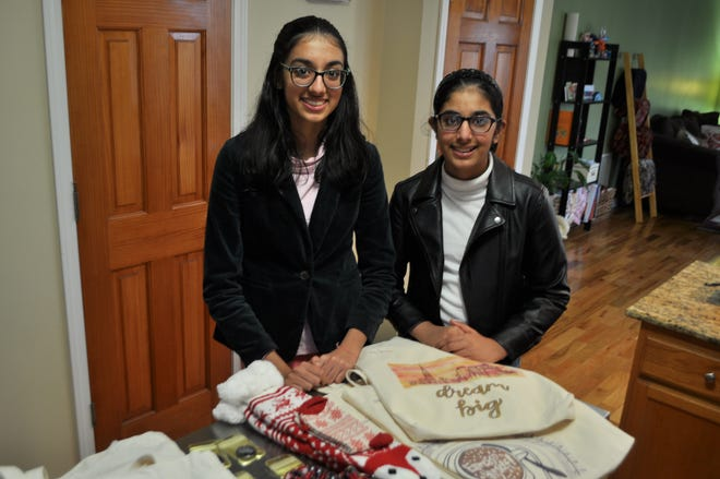 Yosna (left) and Nysa Bareja, students at Dublin Coffman High School and Sells Middle School, respectively, showcase products available via Sisters' Creation, an online business they created, with proceeds to benefit two charities: the World Wildlife Fund and the TeenGirls Development Foundation.
