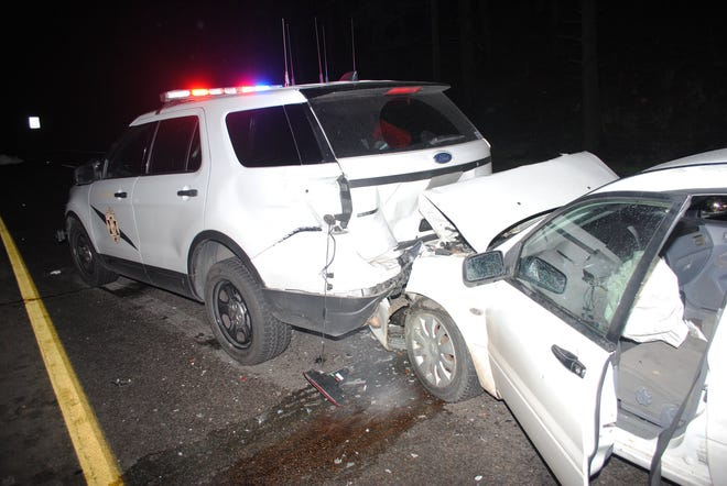 A driver struck a Washington State Patrol vehicle early Sunday morning.