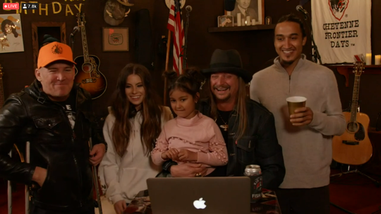 Kid Rock (center) holds his granddaughter, Skye, during his 50th birthday hangout, streamed Jan. 17, 2021, from Whites Creek, Tenn. Also pictured, from left, are Billy Ritchie, Marisa Trovato and Bobby Ritchie Jr.