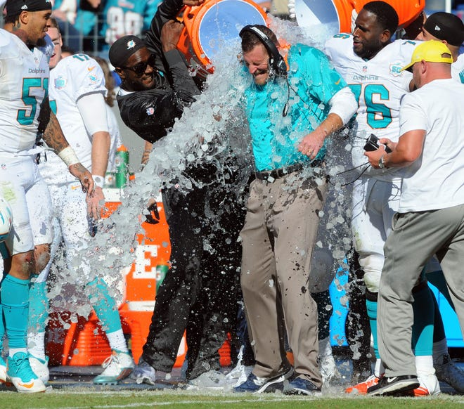 The Dolphins douse interim coach Dan Campbell after beating Tennessee 38-10 in his first game as interim coach in 2015.
