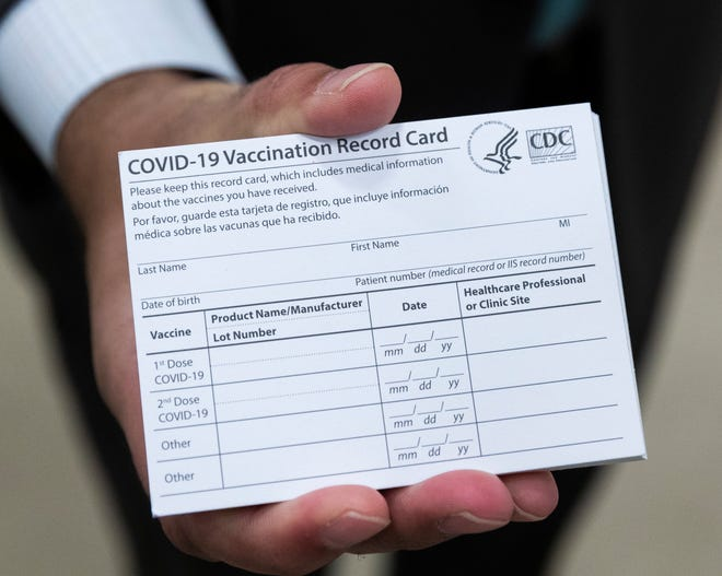 A COVID-19 vaccination card is shown at the Prevea COVID-19 vaccination clinic Monday, Jan. 18, 2021, at UW-Green Bay's Kress Events Center in Green Bay, Wis.