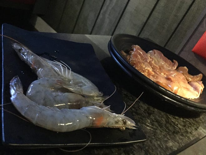 Shrimp and chicken await their turn on the grill at Q Korean Steakhouse.
