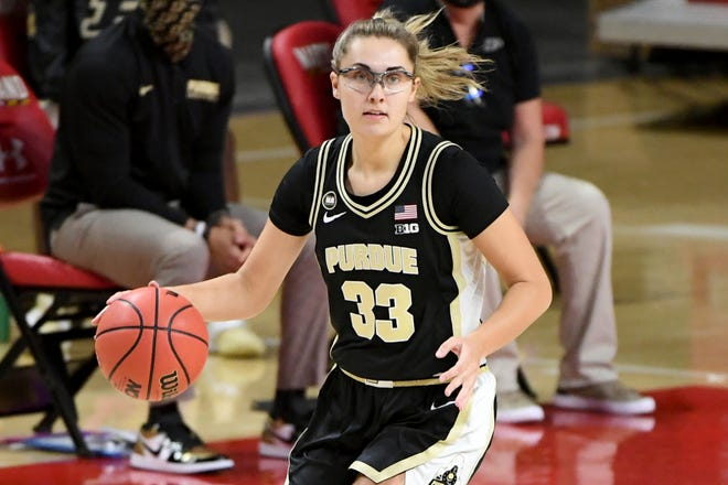 Purdue guard Madison Layden (33) dribbles against Maryland during the first half of an NCAA college basketball game, Sunday, Jan. 10, 2021, in College Park, Md. Layden scored 19 points Monday in Purdue's 87-81 loss at Iowa. (AP Photo/Will Newton)