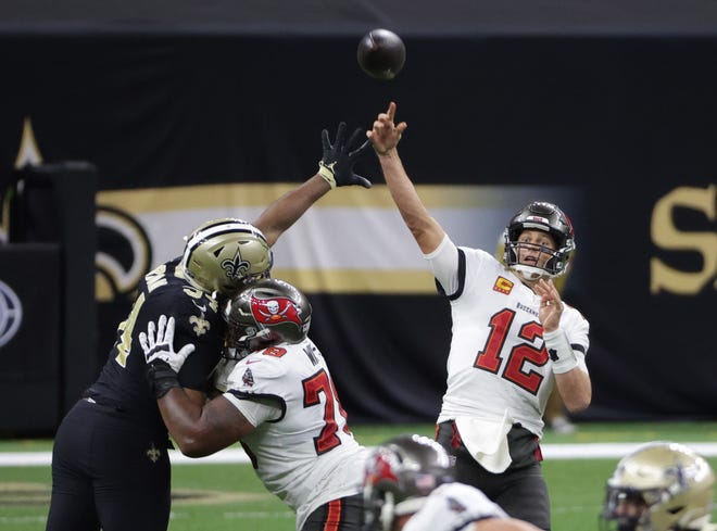 Tampa Bay Buccaneers quarterback Tom Brady throws a pass against the New Orleans Saints during the Tampa Bay's 30-20 win Sunday in New Orleans. The Bucs will play Green Bay in the NFC conference championship game Sunday.