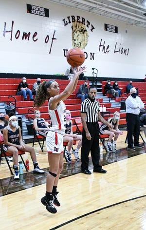 Liberty Union sophomore Delaney Peck attempts a 3-point shot during a game earlier this season. Peck scored seven points to help lead the Lions to a come-from-behind win over Teays Valley.