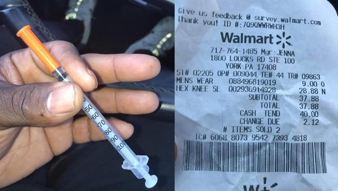 Walmart is investigating an incident at its West Manchester Township location after a York City father found a needle inside a sweatshirt he bought for his son on Saturday, officials confirmed Monday.