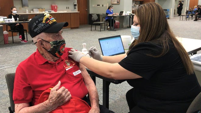 Marine Edgar Fox, 98, wanted to be the first in his category to get his COVID-19 vaccine at Mercy Hospital Springfield.