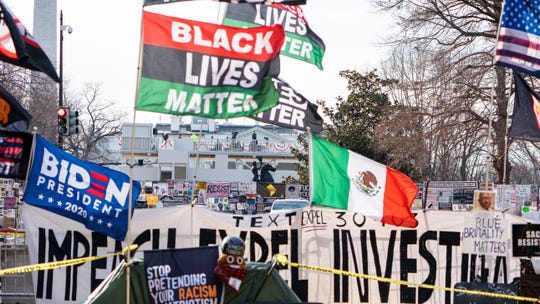 Flags take over the view towards the White House in Black Lives Matter Plaza during Martin Luther King Day celebrations on Jan. 18, 2021 in Washington, D.C. The nation's capital is still on high-alert with heightened security against threats to President-elect Joe Biden's inauguration following the deadly pro-Trump insurrection.