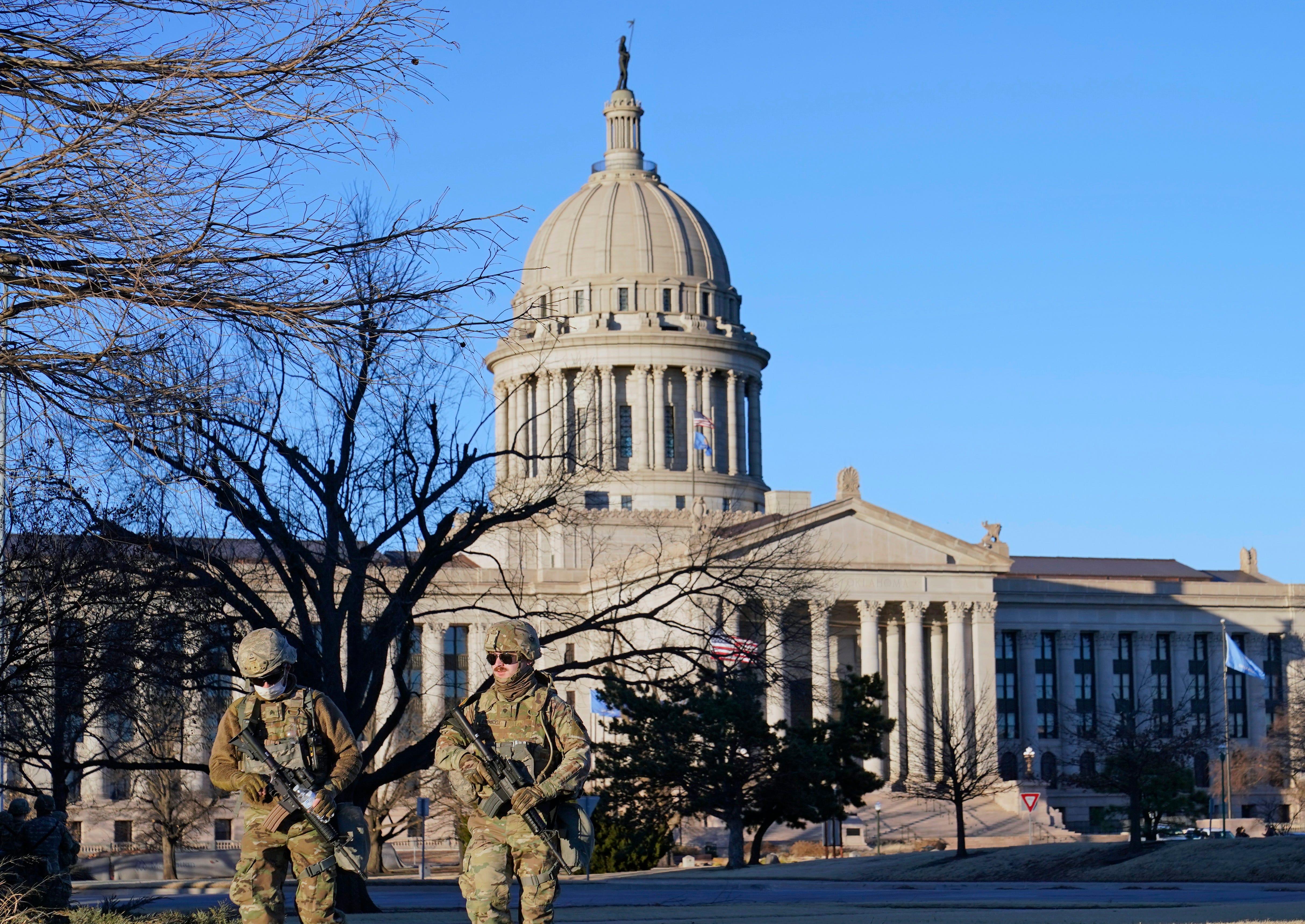 Oklahoma National Guard members patrol the mostly empty grounds near the Oklahoma Capitol on Sunday.