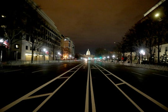 Pennsylvania Ave., leading to the U.S. Capitol in Washington, D.C. was empty Sunday night, Jan 17, 2021. The nation's capital was on high-alert with heightened security against threats to President-elect Joe Biden's inauguration following the deadly pro-Trump insurrection at the U.S. Capitol.