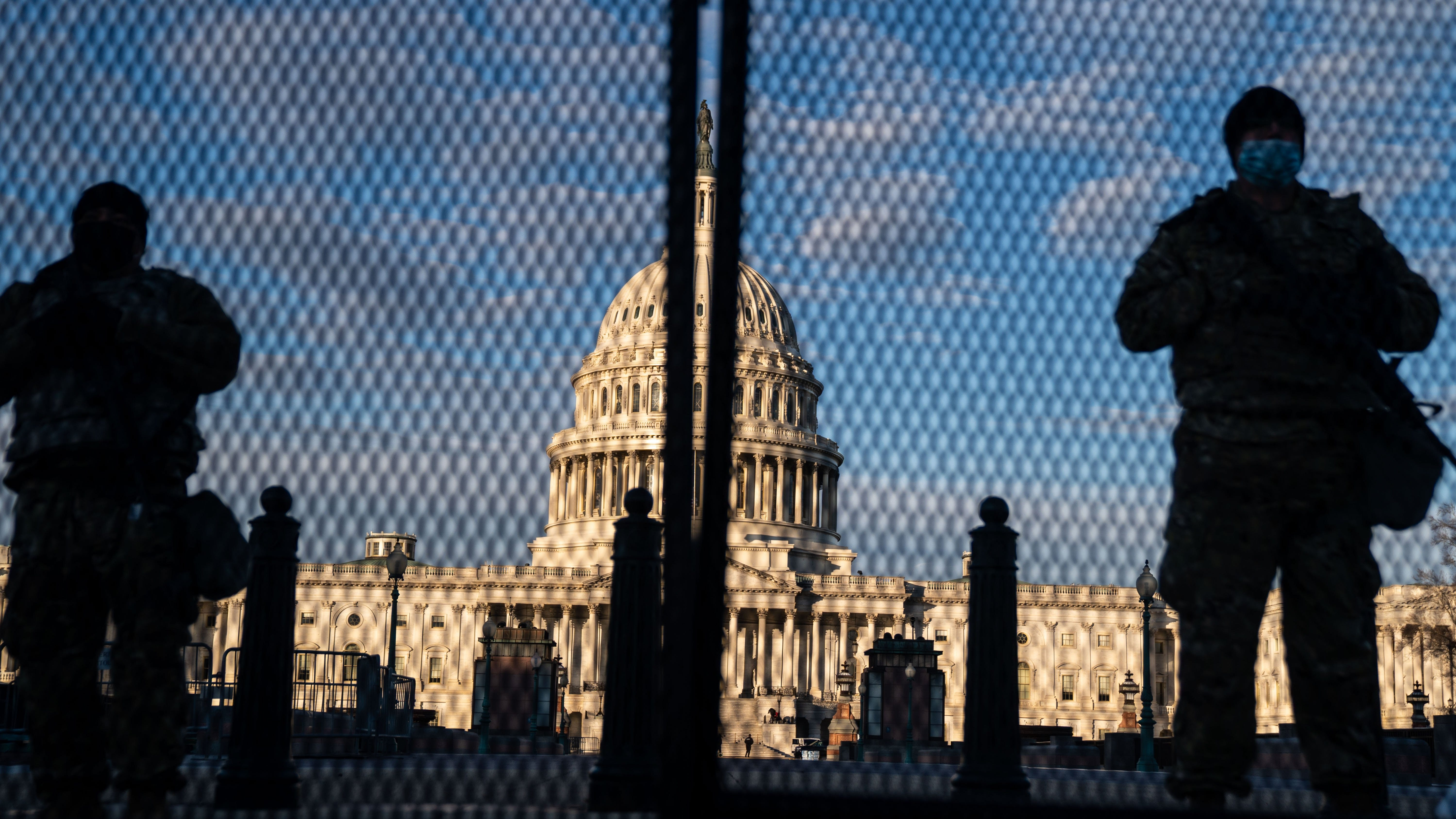 National Guard troops stand behind security fencing with the dome of the U.S. Capitol Building behind them on Saturday in Washington, D.C. [KeENT NISHIMURA/LOS ANGELES TIMES/TNS]