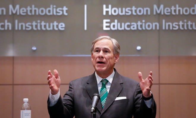 Gov. Greg Abbott talks to the media Tuesday after holding a COVID-19 vaccination roundtable discussion with health care professionals at Houston Methodist Hospital.