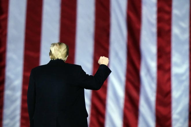 President Donald Trump gestures at a campaign rally in support of U.S. Senate candidates Sen. Kelly Loeffler, R-Ga., and David Perdue in Dalton, Ga., on Jan. 4. [AP PHOTO/BRYNN ANDERSON]