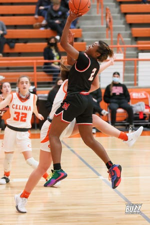 Senior Mia Ellis (2) is from a long line of Melissa superstars. Here she takes a shot for 3 points late in the 1st half. Mia stole the ball numerous times with her tight press of Celina.