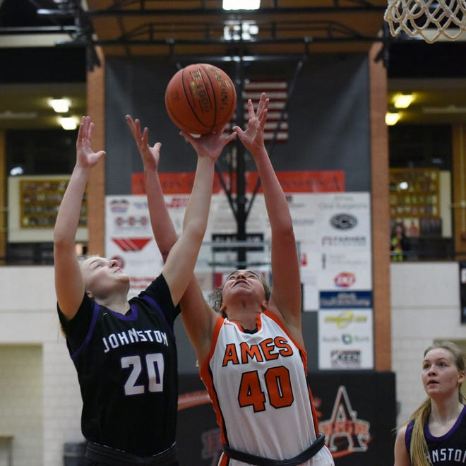Ames' Kennedy White battles Johnston's Anna Gossling for a rebound during the second half of the Little Cyclones' 71-54 loss to the No. 1 Dragons Monday in Ames. White had 10 points and nine rebounds for a gutsy Ames team that got within 48-45 early in the fourth quarter before running out of gas.