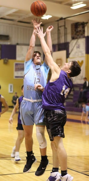 East Beauregard's Skyler Beebe (12) goes up for two points in the post during action Monday at the Anacoco MLK Day JV Shootout.
