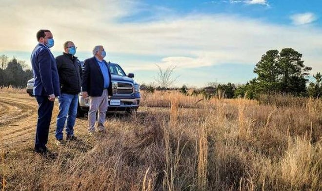 Cherokee Nation Secretary of Natural Resources Chad Harsha and Tribal Councilors Daryl Legg and E.O. Smith tour a new hunting and fishing reserve area for tribal members in Sequoyah County on Monday.