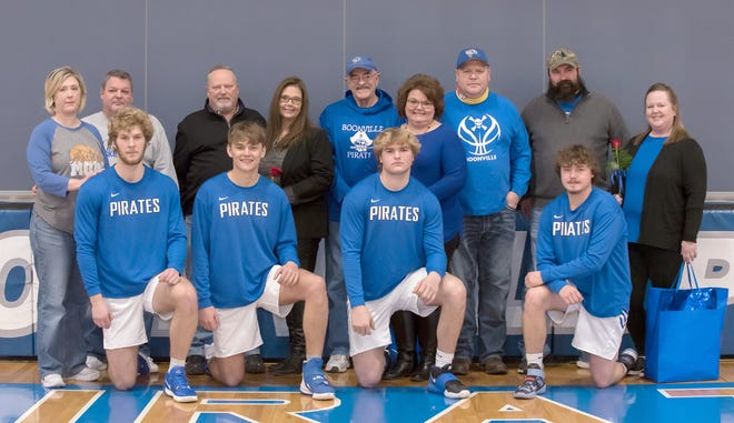 Four senior members of the Boonville Pirates basketball team were honored along with their parents during Senior Night Saturday against Hallsville.