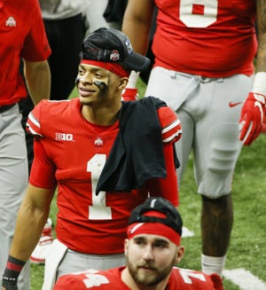 Quarterback Justin Fields cemented his legacy at Ohio State by winning 20 of his 22 starts, with the only losses coming in playoff games.
