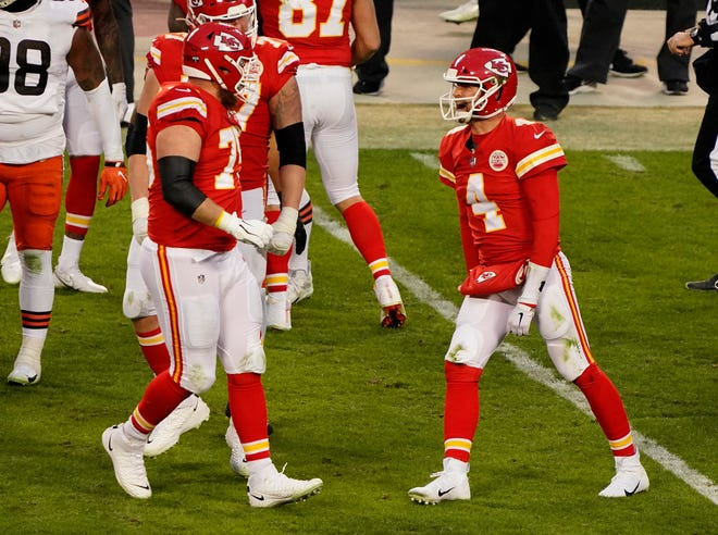 Kansas City Chiefs quarterback Chad Henne (4) celebrates during a divisional-round NFL playoff game against the Cleveland Browns on Sunday at Arrowhead Stadium in Kansas City.