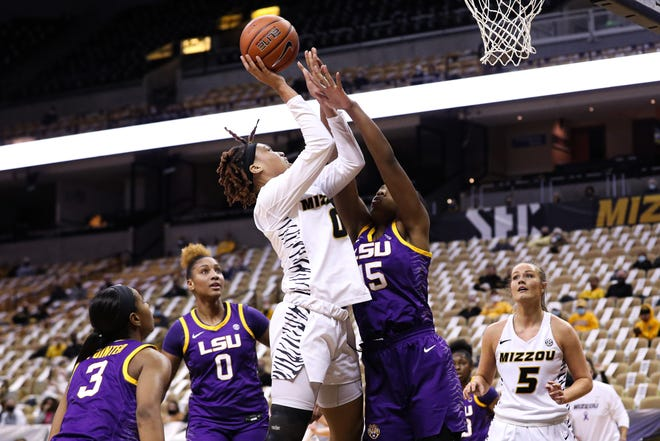 Missouri forward LaDazhia Williams (0) shoots from close range during a game against LSU on Monday night at Mizzou Arena.