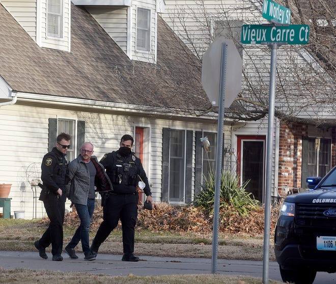 Columbia police take a man into custody at about 4 p.m. Tuesday in the 3300 block of West Worley Street following a road rage incident in which the man allegedly shot the left front fender of another man's pickup truck. The incident began near the Columbia Mall. Police are questioning both men involved in the incident.