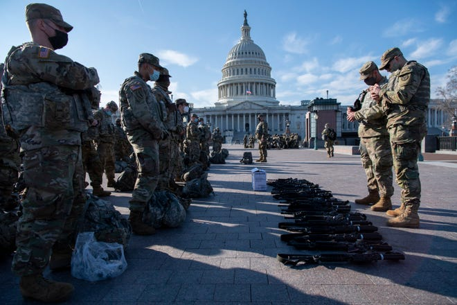 Jan 13, 2021; Washington, D.C., USA; National Guard troops line up as security around the U.S. Capitol is heightened as the House of Representatives reconvenes to debate Trump impeachment following Pro-Trump riots on the Capitol building and ahead of inauguration on Jan. 13, 2021 in Washington.. Mandatory Credit: Jasper Colt-USA TODAY ORG XMIT: USATODAY-446271 (Via OlyDrop)