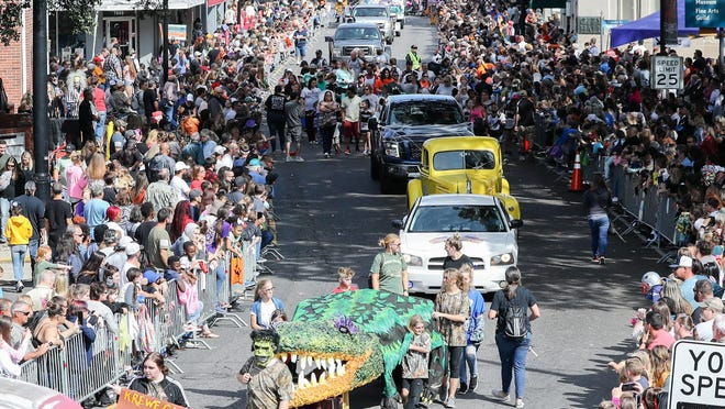 The Krewe Ga Rou parade, part of Houma's annual Rougarou Festival, rolls through downtown Houma in October 2018.