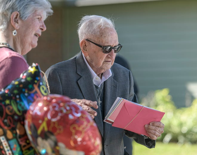 Rev. McCoy Gibbs, center, and his wife Suzanne look through birthday cards at Lake Port Square in Leesburg on Monday, Jan. 18, 2021. [PAUL RYAN / CORRESPONDENT]