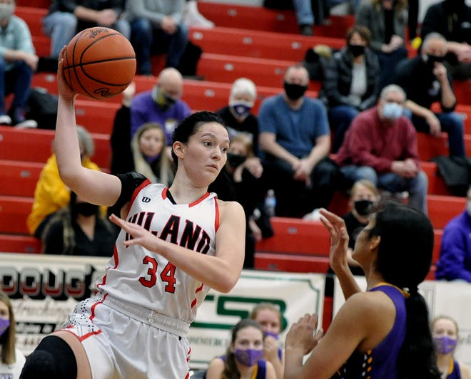 Hiland's Kelsey Swihart passes to a teammate over Jackson's Leena Patibandla. Swihart was one of three Hiland players in double figures, scoring 12 points in the win.
