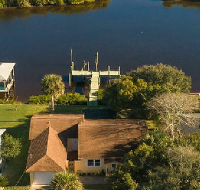 It's hard to beat the price of this direct riverfront home with a deep-water dock.