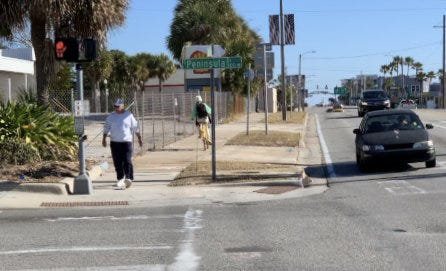 Daytona Beach's East International Speedway Boulevard is in line to get a much-needed $24 million overhaul. Pictured is a man walking past the former Shell gas station on the northeast corner of East International Speedway Boulevard and South Peninsula Drive in January.