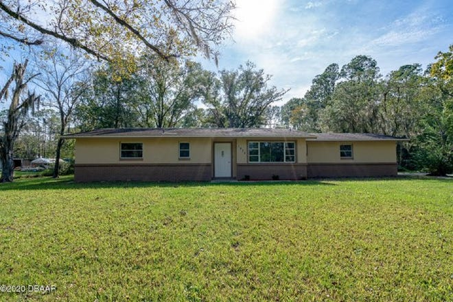 This totally renovated, three-bedroom, two-bath home is located on over two acres in Port Orange, with no HOA.