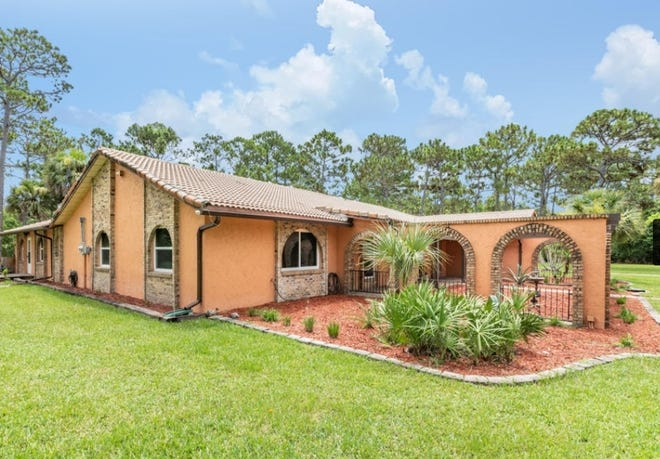 This one-of-a-kind Spanish-style pool home in Ormond Beach's prestigious and gated community of Eagle Rock sits on five acres and is equipped with an extra-large, four-stall horse stable.