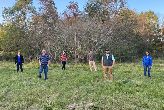 The Ascension Chamber's Leadership Ascension class partnered with the parish to bring the first dog park to the Prairieville area. Members are shown at the location along Hwy. 929.